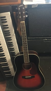 red and black acoustic guitar