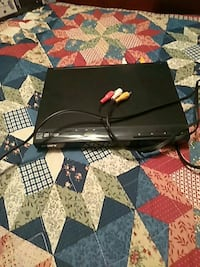 black Sony DVD player with RCA cable