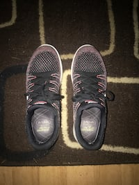 Pair of black nike running shoes Springfield, 22153