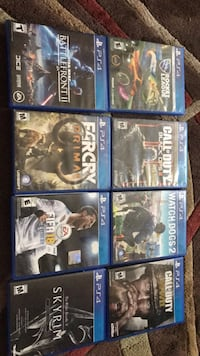 six assorted PS4 game cases
