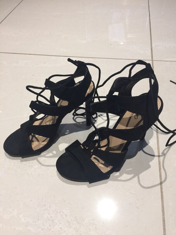 Pair of black strappy heels