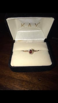 Size 7 rose gold oval garnet ring with diamond accents Glens Falls, 12801