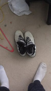 pair of white-and-black Nike cleats North Bethesda, 20852