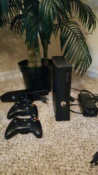 black Xbox 360 console, two controllers.