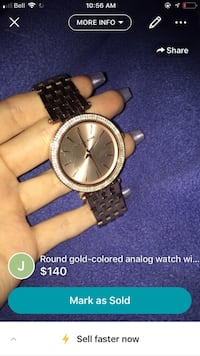 round gold-colored analog watch with link bracelet screenshot Lower Sackville, B4C 3Z1