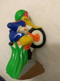 Rare Woody Woodpecker riding on motorcycle or bike