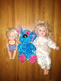 two baby plastic dolls and one blue dog plush toy Belleville, K8P 3C5