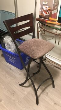 brown wooden framed padded chair