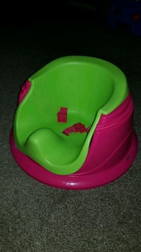 baby's green and pink floor seat