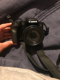 Black canon eos dslr camera 507 mi