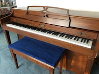brown and white upright piano 43 km