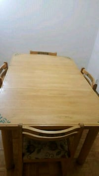 rectangular brown wooden table with four chairs dining set Montréal, H3V 1G7