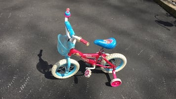 Toddler's bicycle with training wheels. In excellent condition.