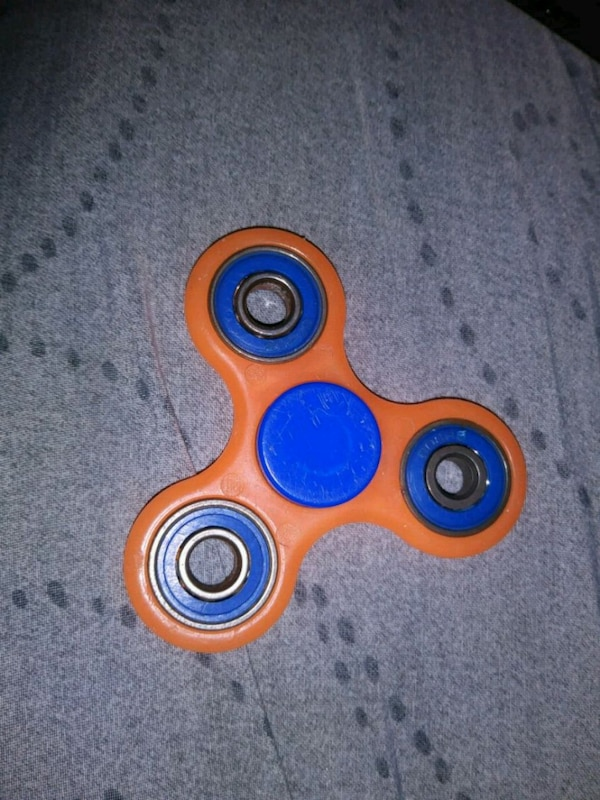 orange and blue hand spinner