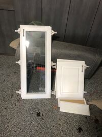 Two sets glass cabinets doors