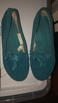 pair of blue suede boat shoes null