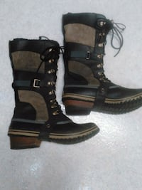 brown-and-black leather duck boots London