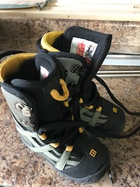 pair of black-and-yellow snowboard boots