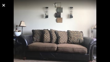 Leather/fabric couch and loveseat
