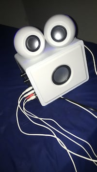 white 3.1 channel speakers