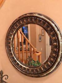 round brown wooden framed mirror