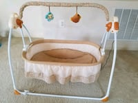 baby's white and brown bassinet Silver Spring, 20906