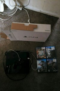 playstation model cuh-1115a with 4 games