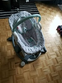 baby's green and gray cradle and swing