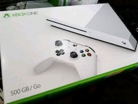 white Xbox One console with controller Daly City