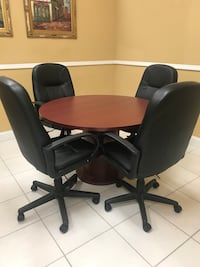 Round conference table and leather chairs Hialeah, 33016