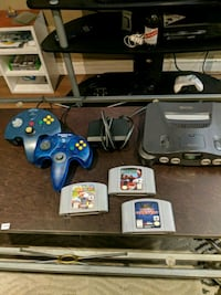 black Nintendo 64 console with controllers and gam Kitchener, N2A 3T7