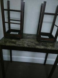 rectangular gray and black table with two chairs