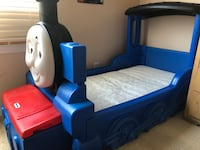 blue and red plastic bed frame
