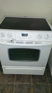 white and black induction range oven Montreal, H1K 2X5