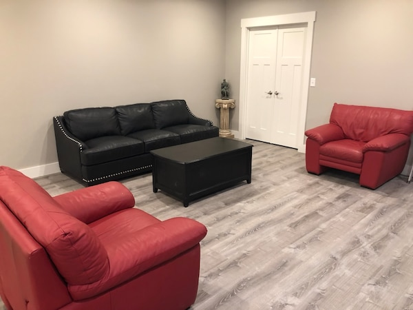 Black leather sofa with 2 red leather chairs