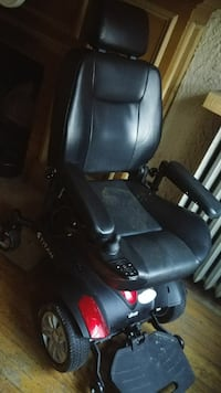 black and red powered wheelchair
