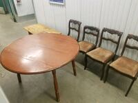 round brown wooden table with four chairs dining set Burnaby, V5G 4X1