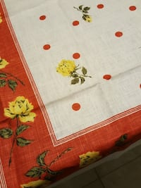 white red and yellow flower print textile