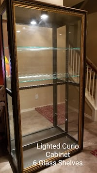 brown wooden framed glass display cabinet Missouri City