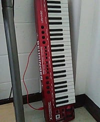 red and white electronic keyboard
