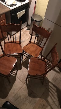 four brown wooden windsor chairs Farmingville, 11738