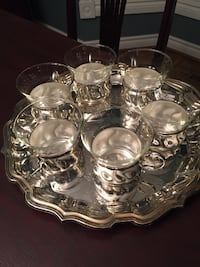 Clear cut glass cups with silver holders. Tray NOT included Mississauga, L5M 4M7