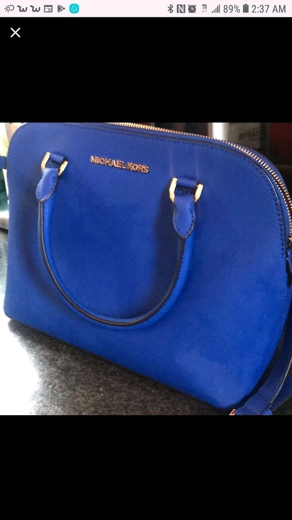 blue leather Michael Kors handbag