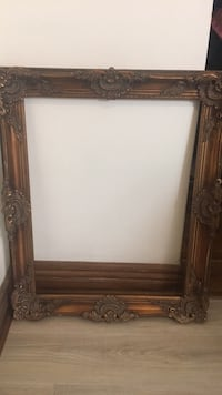 "Brown wooden 22"" x 28"" picture frame"