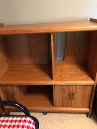 Nice oak entertainment center. Can be used as bookcase. Perhaps is 55' x 32 wide. HASTINGS