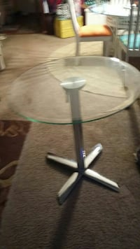 Round glass table ,H 29' W 27'
