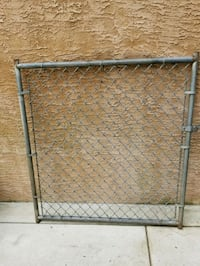 Gate for cyclone fence.