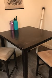 High table with two chairs