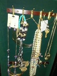 assorted gold-colored jewelries
