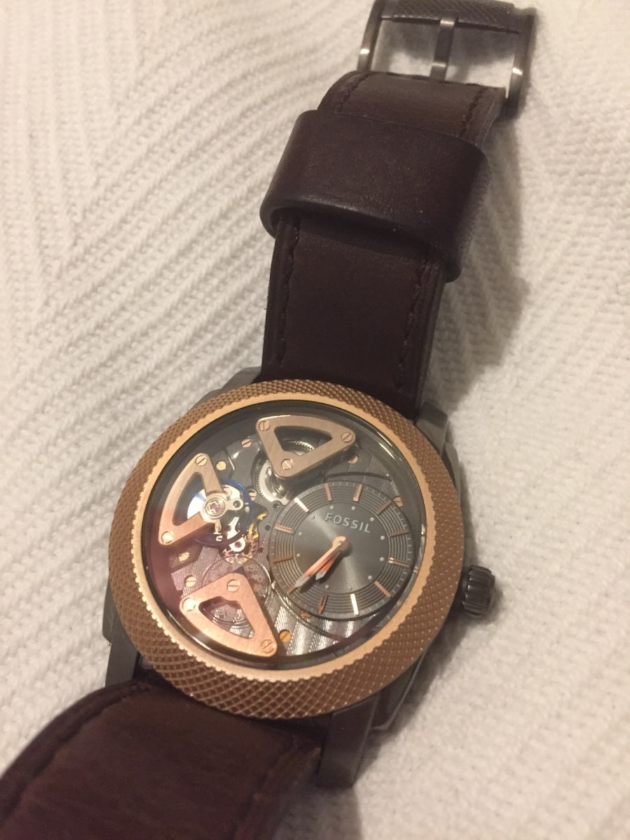 round brown Fossil chronograph watch with brown leather strap